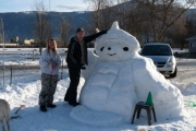 Team Breedveld (Randy and Suzanne) with their winning snow sculpted Olympic mascot; Photo, Mona Mattei
