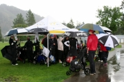 The rain got so bad that many of the golfers began huddling under the first hole tent or even under trees between plays. Photo Erin Perkins.