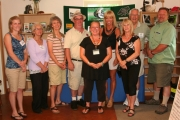 A group of politicians and CLSS members pause for a photo during the open house. Photo Erin Perkins.
