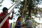 Thanks to many volunteer hands the teepee went up quickly. Photo Erin Perkins.