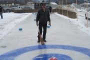 Ice technician Guy Dubeault built a small version of a curling rink in his back yard for New Year's celebrations; Photo, Gerry Foster