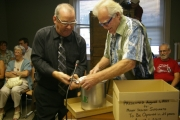 Councillor Gary Smith assists mayor Brian Taylor in opening the capsule; Photo, Mona Mattei