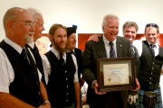 Grand Forks Pipes and Drums with Mayor Brian Taylor and their award; Photo, Mona Mattei