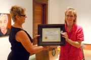 Councillor Cher Wyers (L) gives Shawna Schuh her award; Photo, Mona Mattei