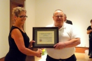 Cliff Schuh (R) accepts his award from Councillor Cher Wyers;  Photo, Mona Mattei