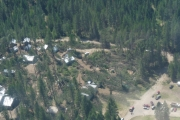 An aerial view of Pines Bible Camp clearly showing the path of the wind storm; Photo, Mona Mattei