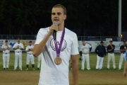 Olympic bronze medalist Richard Weinberger from Victoria takes the pitcher's mound; Photo, Mona Mattei
