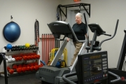 Liz Martin is one of many people who use the current fitness room at the Aquatic Center. The space just doesn't work for the number of people who use it. File photo.