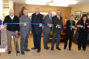 The official cutting of the ribbon at Silver Kettle Village in Grand Forks. (L-R) Mr. Campbell (a new resident), Endre Lillejord, MLA John Slater, mayor Brian Taylor, city councillor Patrick O'Doherty, Cindy Kozak-Campbell, and manager Michele Shiliker