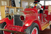 Grand Forks Volunteer Fire Department attended to discuss the possibility of displaying their five restored antique fire trucks and other apparatus at the museum. — Screen Shot photo