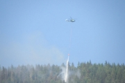 Helicopters continue to drop water on the Slocan Park wildfire. — Photo courtesy Jenn Bayes