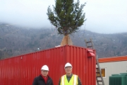 Wally Penner (right) is joined to help light the Christmas Tree at the Waneta Expansion power project one last time.