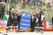 The captains of the Saints, from left (18) Scott Swiston, (27) Logan Proulx, (91) Jordan Wood and (5) Dylan Smith accept the hardward and banner Saturday during the award ceremony at the NDCC Arena. — Bruce Fuhr photo