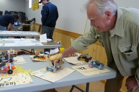 Grand Forks Mayor Brian Taylor checks out one of the solar cars designed by Hutton Elementary students; Photo, Mona Mattei