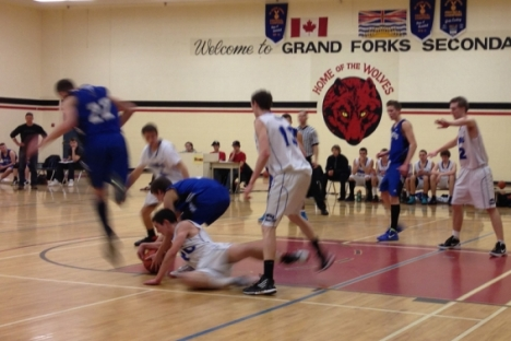 LVR's John Zak (white) goes to the floor during action in the Kootenay AA Boy's Final Saturday in Grand Forks.
