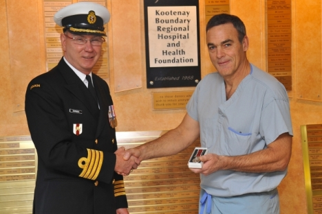 Capt. Timothy Kavanagh presents the GSM to Dr. Steve McVicar